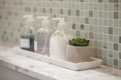 Liquid soap bottle with tile background Bathroom accessories. Modern Liquid soap bottle with tile background Bathroom accessories Stock Images