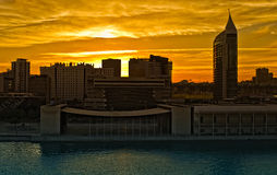 Modern Lisbon. Neighborhood including Vasco da Gama Tower surrounded by orange sky at sunset Stock Image