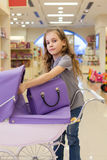 Modern little girl in a toy store Royalty Free Stock Image