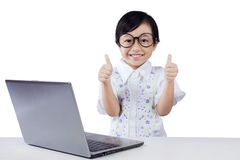 Modern little student with laptop and OK sign Royalty Free Stock Photos