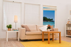 Modern living room. With view on a tropical beach Royalty Free Stock Photo