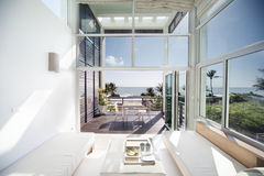 A modern living room. Luxury living room with ocean view looked on the window Royalty Free Stock Image