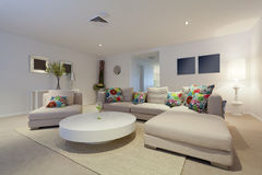 Modern living room. With couch and round table in new Australian apartment Royalty Free Stock Images