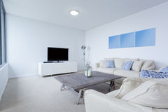 Modern living room. With couches and TV in new Australian apartment Royalty Free Stock Image
