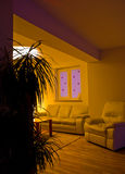 Modern Living Room. Partial view of a modern living room with warm lighting Royalty Free Stock Images