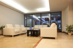 Modern Living room. With white furniture and big windows Stock Photos