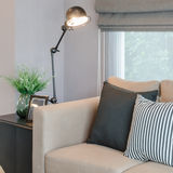 Modern living room with black lamp on table side stock image