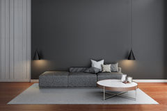 Modern living room with black wall 3d rendering. Gray sofa in black room Royalty Free Stock Images