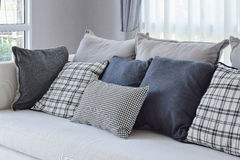 Modern living room with black and white checked pattern pillows Royalty Free Stock Photo