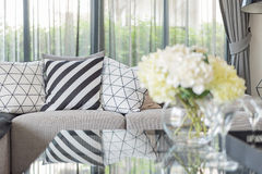 Modern living room with black and white pillows on grey sofa Royalty Free Stock Photo