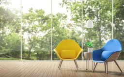 Modern living room with blurry background 3d rendering image. There are a wooden floor. Large windows overlook the garden. Decorated with yellow and blue chairs Royalty Free Stock Image