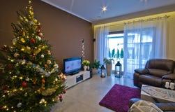 Modern living room at Christmas season. Royalty Free Stock Photo