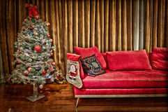 Modern living room with decorated christmas tree. Modern living room with red sofa and a decorated christmas tree Royalty Free Stock Photography