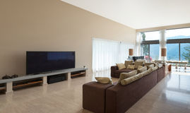 Modern living room, divan. Interior of a modern living room, comfortable divan royalty free stock photo