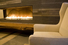 Modern living room with fireplace Stock Images