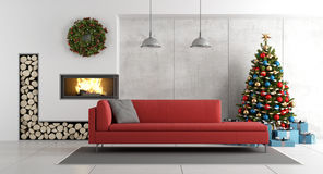Modern living room with fireplace and christmas tree. Modern living room with fireplace , christmas tree ,present and red sofa - 3d rendering Royalty Free Stock Images