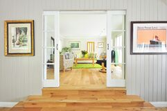Modern living room with French doors Stock Photos