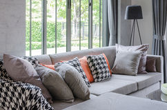 Modern living room with grey sofa and pillows Stock Photography