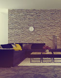 Modern living room interior with accent brick wall Royalty Free Stock Image