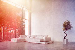 Modern living room interior with bright sun flare Royalty Free Stock Photography