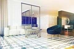 Living room white sofa, blue armchair toned. Modern living room interior with a checkered floor, black walls and a white sofa with a blue armchair near a round Royalty Free Stock Image
