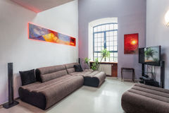 Modern living room. Interior with comfortable grey sofa Royalty Free Stock Photography