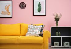 Modern living room interior with comfortable sofa near color wall. Modern living room interior with comfortable yellow sofa near color wall royalty free stock photo