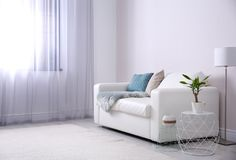 Modern living room interior with comfortable sofa. Space for text stock photography