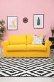 Modern living room interior with comfortable yellow sof. A near color wall royalty free stock images