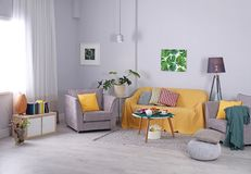 Modern living room interior with cozy sofa and armchairs Royalty Free Stock Photos