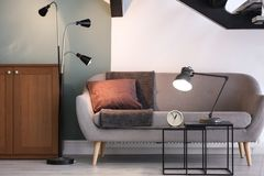 Modern living room interior with lamps. And comfortable sofa Stock Photography