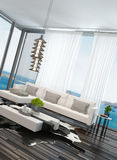 Modern living room interior overlooking the ocean Stock Photo