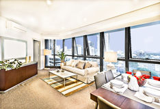 Modern living room interior with sofa set near city. Stock Photos