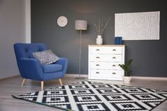 Modern living room interior with stylish armchair. And carpet stock photography