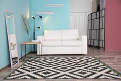 Modern living room interior with stylish sofa Stock Photography