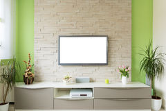 Modern living room interior - tv mounted on brick wall with white screen.  royalty free stock photos