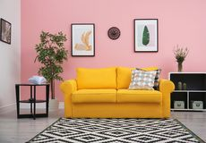 Free Modern Living Room Interior With Comfortable Yellow Sofa Royalty Free Stock Photo - 122734195