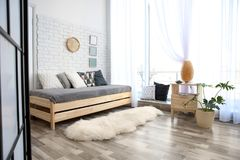 Modern living room interior with wooden furniture. And furry carpet royalty free stock photos