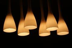 Modern living-room lamp. Modern design hall lamp in the dark Royalty Free Stock Photo