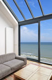 Modern living room with large windows Stock Image