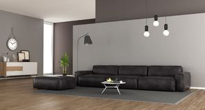 Modern living room with leather sofa stock photography