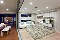 Modern living room lighting with decoration at night Stock Photography