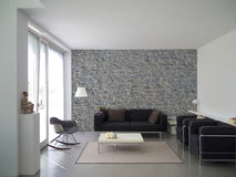 Modern living room with natural stone wall Stock Photo