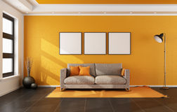 Modern living room with orange wall Royalty Free Stock Photo