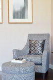 Modern living room with pillow on gray armchair Stock Photography