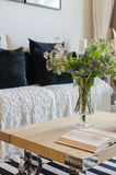 Modern living room with plant in vase and book on wooden table Royalty Free Stock Photos