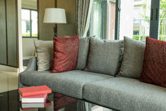 Modern living room with red pillows on sofa Stock Photos