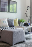 Modern living room with row of pillow on sofa Stock Photos