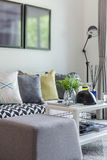 Modern living room with row of pillow on sofa at home Royalty Free Stock Photos