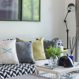 Modern living room with row of pillows on sofa at home Royalty Free Stock Photos
